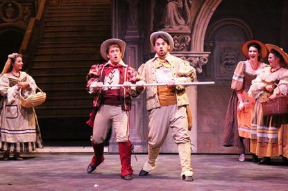 """Logan Rucker, left, as Marco and Andrew Thomas Pardini as Giuseppe in the Young Vic production of """"The Gondoliers"""""""