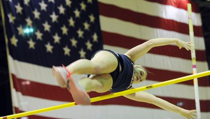Olivia Gruver of Franklin, now the NCAA women's pole vault champion, clears the bar at the Baltimore County indoor championships at the 5th Regiment Armory in Baltimore in January 2013.
