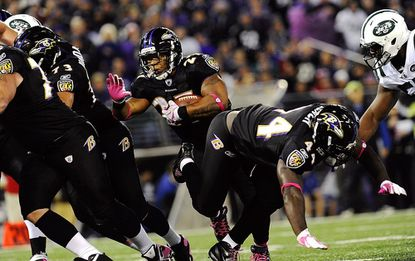 Ray Rice carries three yards for a touchdown in the first half of the Ravens' 34-17 win over the New York Jets at M&T Bank Stadium in Baltimore, October 2, 2011.