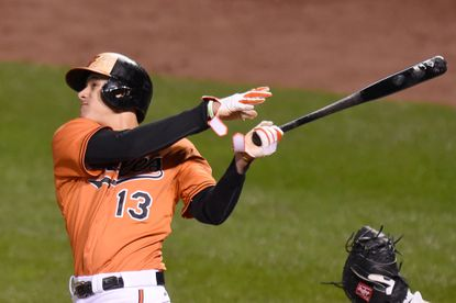 Orioles'Manny Machado hits a solo home run in the third inning during Game 2of a doubleheader against the New York Yankees at Camden Yards on Oct. 3, 2015 in Baltimore.