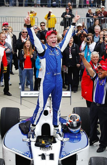 Former Indy Lights driver Josef Newgarden celebrates after winning the Firestone Freedom 100 Indy Lights race at the Indianapolis Motor Speedway in Indianapolis May 27, 2011. Newgarden, who finished second in last year's Indy Lights race in Baltimore, is a rookie in IndyCar and drives for popular former driver Sarah Fisher.