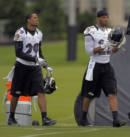 Cary Williams and Jimmy Smith get ready for practice during organized team activities in June.