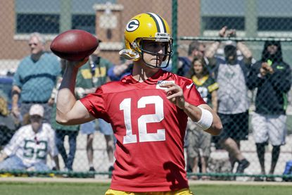 Packers quarterback Aaron Rodgers throws a pass during minicamp in Green Bay, Wis.