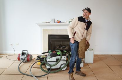 Michael Valente of Renovation Sells, who specializes in preparing homes to sell, works in one of the homes he's renovating at 21 E. Huron St., listed by Barbara Stone with the Lowe Group at Compass, on Feb. 6, 2020.