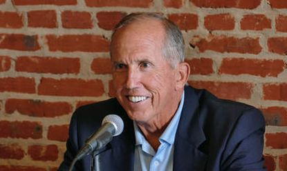 Davey Johnson talks with the media in the warehouse during pregame ceremonies at Camden Yards commemorating the 50th anniversary of the Orioles' 1966 World Series championship team.