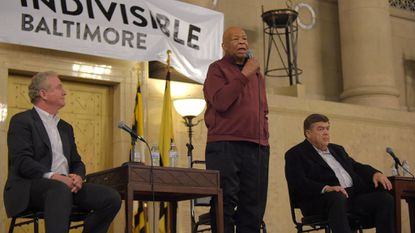 Rep. Elijah Cummings speaks during a previous Baltimore town hall. Sen. Chris Van Hollen (left) and Rep. C. A. Dutch Ruppersberger were also on stage.