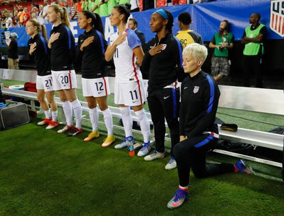 ATLANTA, GA - SEPTEMBER 18: Megan Rapinoe #15 kneels during the National Anthem prior to the match between the United States and the Netherlands at Georgia Dome on September 18, 2016 in Atlanta, Georgia. (Photo by Kevin C. Cox/Getty Images) ** OUTS - ELSENT, FPG, CM - OUTS * NM, PH, VA if sourced by CT, LA or MoD **