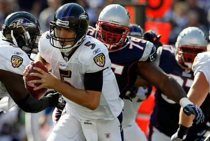 Vince Wilfork chases Joe Flacco in the first half of a 2010 playoff game at Gillette Stadium.
