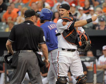 After another look, Buck Showalter says umps were right on catcher's interference