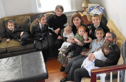 Joshua Runyan with his wife, Tamar, and their eight kids. A recent Pew Center study suggests that Orthodox Judaism is now the fastest-growing branch of the faith in the U.S.