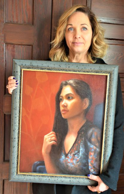 """Michele Araquette is pictured with her painting titled """"Natalie,"""" the owner of """"Salon by Natalie"""" in Westminster."""