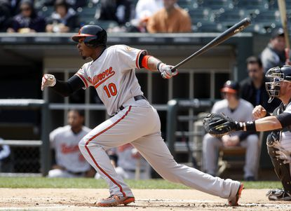Adam Jones hits a double against the Chicago White Sox.