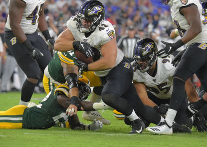 Ravens defensive lineman Patrick Ricard (42) recovers a Green Bay Packers fumble during the third quarter of the second preseason game against the Green Bay Packers Thu., Aug. 15, 2019. Baltimore won, 26-13.