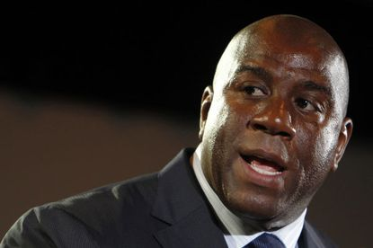 Magic Johnson will invest millions of his own into buying the Dodgers, but how much time will he invest?
