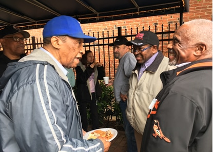 Onetime Negro Leagues player Pedro Sierra, left, swaps baseball stories with former Orioles centerfielder Al Bumbry at the Babe Ruth Museum on Saturday as the Rev. Bill Benson of Manna Bible Baptist Church in Park Heights listens in.