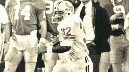Maryland's Lou Carter (Arundel) carries the ball in the Peach Bowl on Dec. 29, 1973. He was named the game's most valuable offensive player. Georgia won, 17-16.