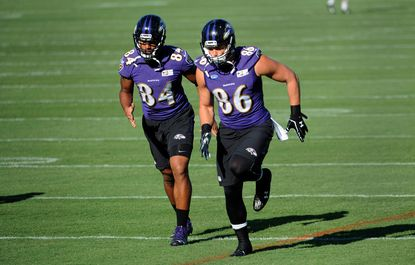 Darren Waller, left, and Nick Boyle, right, run at Ravens training camp.