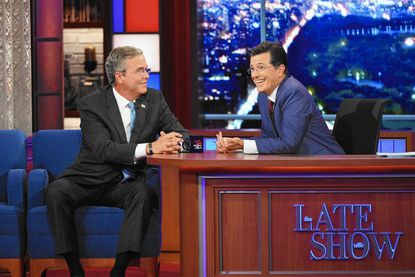 "Stephen Colbert, right, talks with Republican presidential candidate Jeb Bush during the premiere episode of ""The Late Show,"" Tuesday Sept. 8, 2015, in New York."