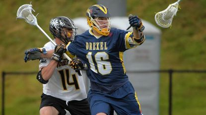 Drexel midfielder Will Manganiello (16) watches the ball and his stick fly out of his hands while defended by Towson defensive midfielder Zach Goodrich (14) during the 2017 CAA semifinal at Johnny Unitas Stadium.