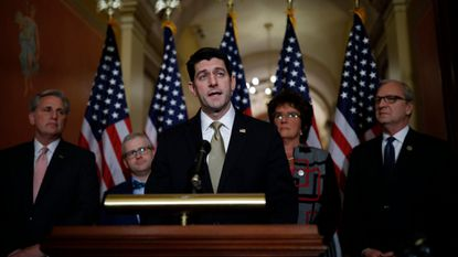 Speaker of the House Paul Ryan speaks at a news conference at the U.S. Capitol on Thursday in Washington, DC. A continuing resolution to fund the government has passed the House of Representatives but faces a stiff challenge in the Senate.
