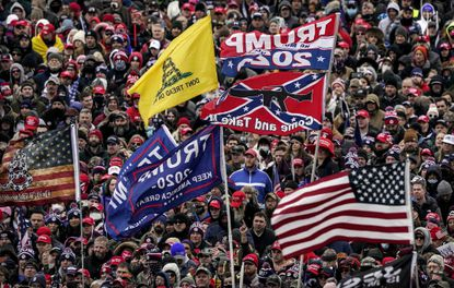 FILE - This photo from Wednesday Jan. 6, 2021, show supporters of President Donald Trump, with a Confederate-themed flag among others, listening to him speak as they rally in Washington before the deadly attack on the U.S. Capitol. (AP Photo/Evan Vucci, File)