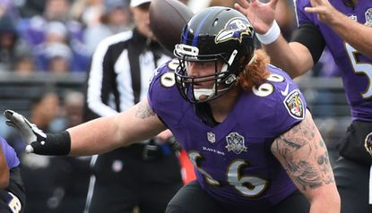 Ravens offensive lineman Ryan Jensen plays in a game against the St. Louis Rams.