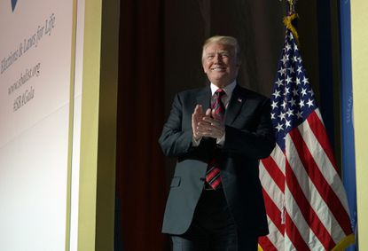 President Donald Trump arrives to speak at the Susan B. Anthony List Campaign for Life Gala at the National Building Museum on May 22, 2018, in Washington.