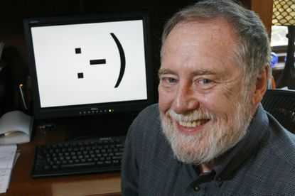 "Carnegie Mellon professor Scott E. Fahlman is shown in his home office in Pittsburgh on Monday, Sept. 17, 2007 -- to mark the 25th anniversary of the invention of the smiley-face emoticon. Three keystrokes -- a colon followed by a hyphen and a parenthesis -- were first used as a horizontal ""smiley face"" in a computer message by Fahlman, the university said. Fahlman posted the emoticon in a message to an online electronic bulletin board at 11:44 a.m. on Sept. 19, 1982."