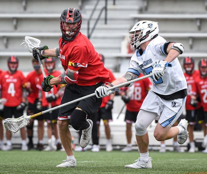 The Terps' Jared Bernhardt (1) tries to get past Johns Hopkins' Connor Delaney (55) during a game April 24, 2021.