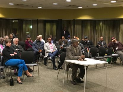 Del. Nathaniel Oaks, sitting at table, will likely represent Northwest Baltimore in the Maryland State Senate after being unanimously recommended by Democratic party officials.