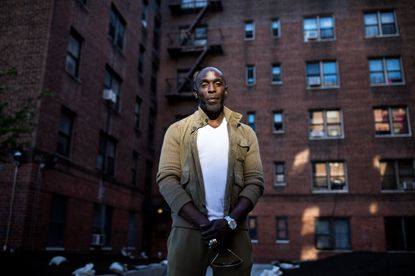 """FILE -- The actor Michael K. Williams outside of his old apartment complex in Brooklyn, June 2, 2017. Williams, whose work as the stickup man Omar Little on """"The Wire"""" made him perhaps the most memorable character on one of the best shows in television history, was found dead at his home in Brooklyn on Sept. 6, 2021. He was 54. (Demetrius Freeman for The New York Times)"""