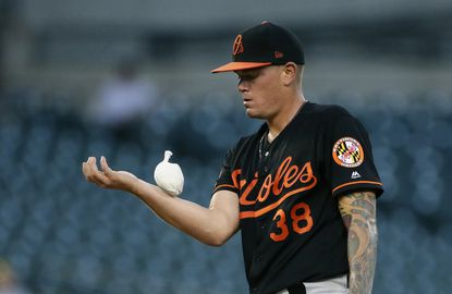 Baltimore Orioles' Aaron Brooks (38) uses a rosen bag during the first inning of a baseball game against the Detroit Tigers Friday, Sept. 13, 2019, in Detroit. (AP Photo/Duane Burleson)