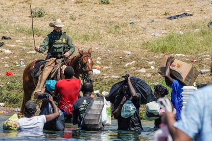 A U.S. Border Patrol agent on horseback uses the reins as he tries to stop Haitian migrants from entering an encampment on the banks of the Rio Grande near the Acuna Del Rio International Bridge in Del Rio, Texas on Sunday, September 19, 2021. (Paul Ratje/AFP/Getty Images/TNS) ** OUTS - ELSENT, FPG, TCN - OUTS **