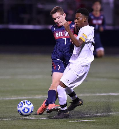 Bel Air's Will Jackson collides with Patterson Mill's Reggie King as they battle for control of the ball during Monday night's game at Bel Air.