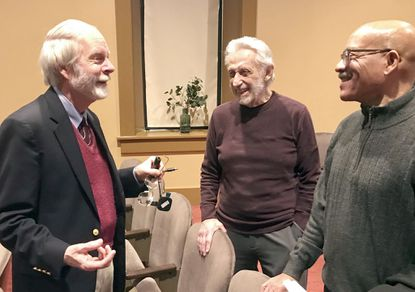"""Author and historian Phillip Hesser, left, talks with Jack Hirschfeld, center, of the Havre de Grace Arts Collective, and Christopher Providence on Monday following Hesser's presentation: """"All Aboard for Philadelphia"""" on how Harriet Tubman and other slaves escaped north to freedom via the Underground Railroad. Hesser gave his talk in The Cultural Center at the Opera House in Havre de Grace."""