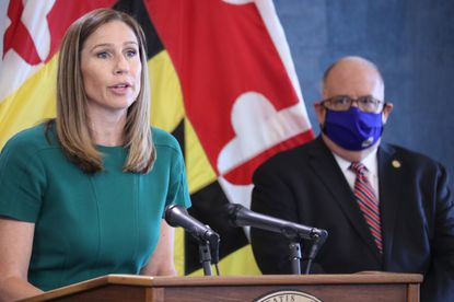 Maryland Labor Department Secretary Tiffany Robinson talks about the state's unemployment insurance claims at a news conference in Annapolis last summer. Gov. Larry Hogan is standing right. (AP Photo/Brian Witte).