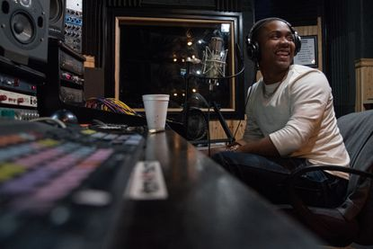 Rapper YGG Tay, seen here recording at a track at Architects Recording Studio on Harford Road, is now facing federal drug and weapons charges after being arrested Monday.