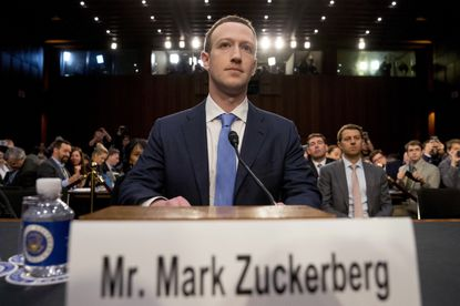 In this Tuesday, April 10, 2018 file photo, Facebook CEO Mark Zuckerberg arrives to testify before a joint hearing of the Commerce and Judiciary Committees on Capitol Hill in Washington. He recently agreed to ban posts from the social media site that deny the holocaust.