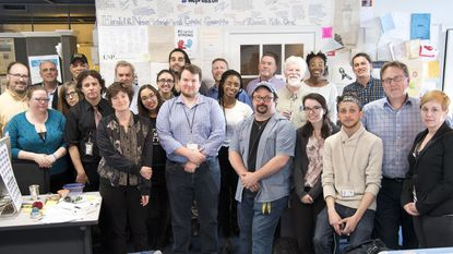 Most of the staff, former staff, and friends of The Capital pose for a photo after being awarded a Pulitzer Prize Special Citation for their work after the shooting at their newsroom on June 28th, 2018. The Capital's parent company, Tribune Publishing, announced Wednesday it would be permanently closing the paper's newsroom in Annapolis.