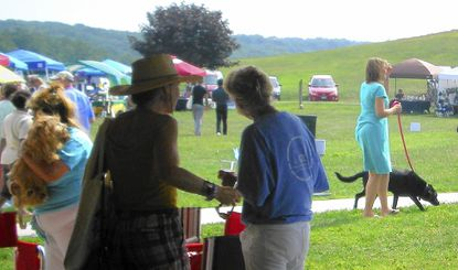 Participants at last year's Animal Welfare League of Frederick County's K9's in the Vine event at Linganore Winecellars in Mount Airy enjoy an afternoon of wine tasting, food, music, pet games and demonstrations.