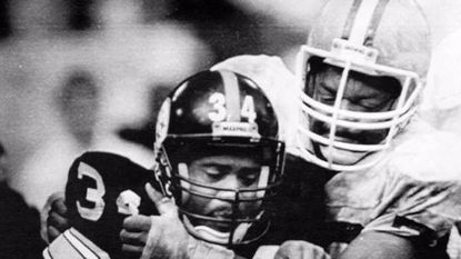 Cleveland Browns defensive end Carl Hairston, right, stops Pittsburgh Steelers running back Walter Abercrombie in 1987.
