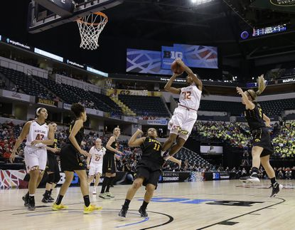 Maryland's Shatori Walker-Kimbrough (32) puts up a shot against Iowa's Tania Davis (11) during the first half of an NCAA college basketball game at the Big Ten Conference tournament Friday, March 4, 2016, in Indianapolis. (AP Photo/Darron Cummings)