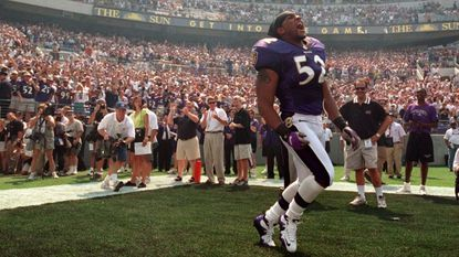 Linebacker Ray Lewis takes the field and fires up Ravens fans during pregame introductions Sept. 10, 2000.