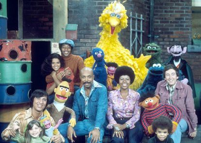 "52 years of 'Sesame Street' history | ""Sesame Street"" is undeniably prolific, with more than 4,500 episodes, 150 countries reached in 70 languages, and 52 years of production. And yet none of these things—all remarkable accomplishments in their own right—begin to convey the true and vast legacy of the show.  That's because ""Sesame Street"" can't just be measured quantitatively (sorry, Count von Count). Its legacy is measured as much by the lessons it taught in kindness and love and grief as it is in the sheer volume of accolades and content it amassed. ""Sesame Street"" <a href=""https://www.sesameworkshop.org/who-we-are/our-history"">began as an attempt to answer one question</a>: Could television be used as a tool to educate all children? Could it transcend socioeconomic barriers, cultural differences, and regional distinctions to become an effective scholastic medium for all? The show proved beyond a shadow of a doubt that the answer to those questions was a resounding yes—and that much more was possible. ""Sesame Street"" showed the world that the things we may perceive as obstacles such as disabilities, insecurities, or differences are worthy of representation and conversation both on- and off-screen. The show established itself as a revolutionary force in children's education and entertainment by thoughtfully developing a curriculum for each season that promotes cognitive, social, and emotional development. Whether a child is counting to 20 or watching a segment about cooperation, ""Sesame Street"" places just as much importance on empathy and cultural competency as it does on mathematical literacy or vocabulary. Researchers have found a <a href=""https://qz.com/1554895/why-kids-who-watched-sesame-street-did-better-in-school/"">positive correlation between children who watched ""Sesame Street"" during their preschool years and improved performance in elementary school</a>. Click through to read about milestone moments from 52 years of ""Sesame Street"" history. (Children's Television Workshop)"