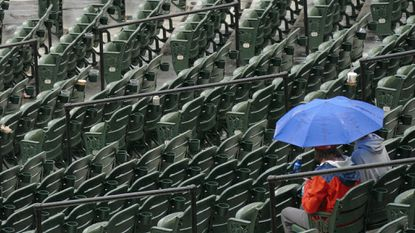 Fans wait out a rain delay, stopping play between the Orioles and the Seattle Mariners at Camden Yards from May 21, 2015.