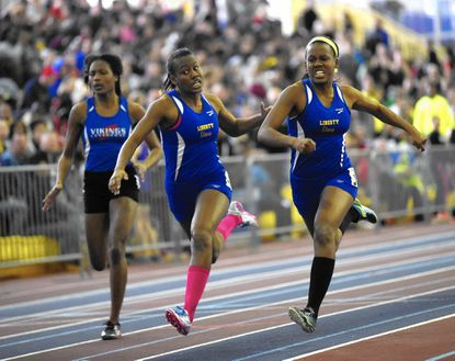 Liberty's Erin Patrice, right, wins the 2A girls 50 meter dash during the MPSSAA State Championship Indoor Track Meet in Landover Monday, Feb 16, 2015. Patrice's twin sister Kara, center finished third. At left is Lansdowne's Ashley Blackwell.