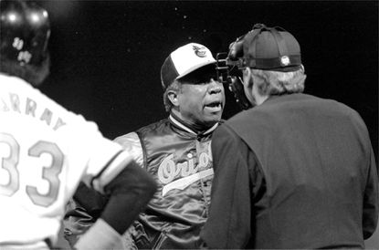It seemed like nothing went the Orioles' way during their 21-game losing streak. The Orioles' new manager, Frank Robinson, is pictured arguing a call with the umpire as Eddie Murray looks on during an O's game versus the Kansas City Royals.