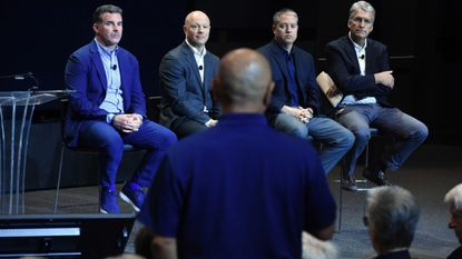Under Armour founder and CEO Kevin Plank, from left, and company executives Patrick Frisk, David Bergman and John Stanton listen to question from a shareholder during the company's annual shareholders' meeting at it company's headquarter in Port Covington.