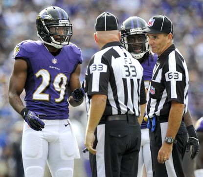 Michael Huff (29) and cornerback Lardarius Webb make their case to the officials after a called penalty in the fourth quarter of the Ravens' 14-6 win over Cleveland in September.