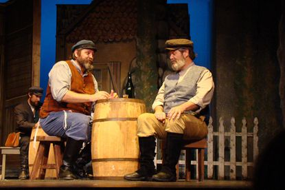 """Tevye (left, played by Fred Nelson) discusses butcher Lazar Wolf's proposal with Wolf (played by Tim Sayles) during 2nd Star's production of """"Fiddler on the Roof"""" at Bowie Playhouse."""